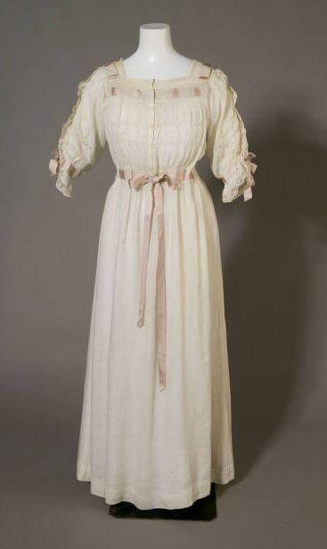 Nightgown: ca. 1880, white cotton, lace, embroidery, silk ribbon.