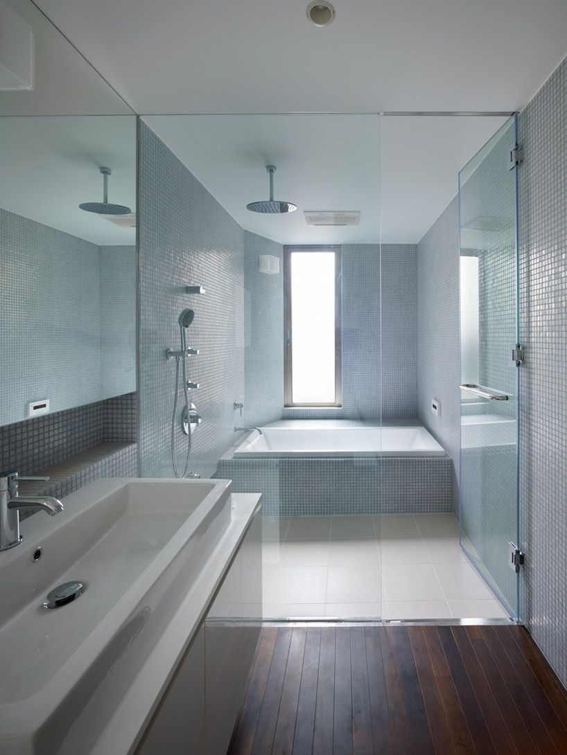 Love the mosaic blue tiles and the tub / shower combo