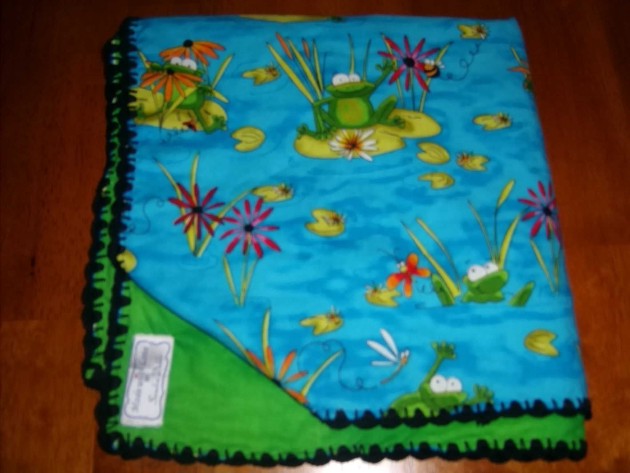 Baby blanket with lily pad and frogs.  Created by name tag.