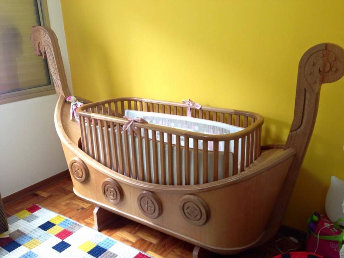 Handmade wooden viking crib/toddler bed combo (crip part comes out and  turns into