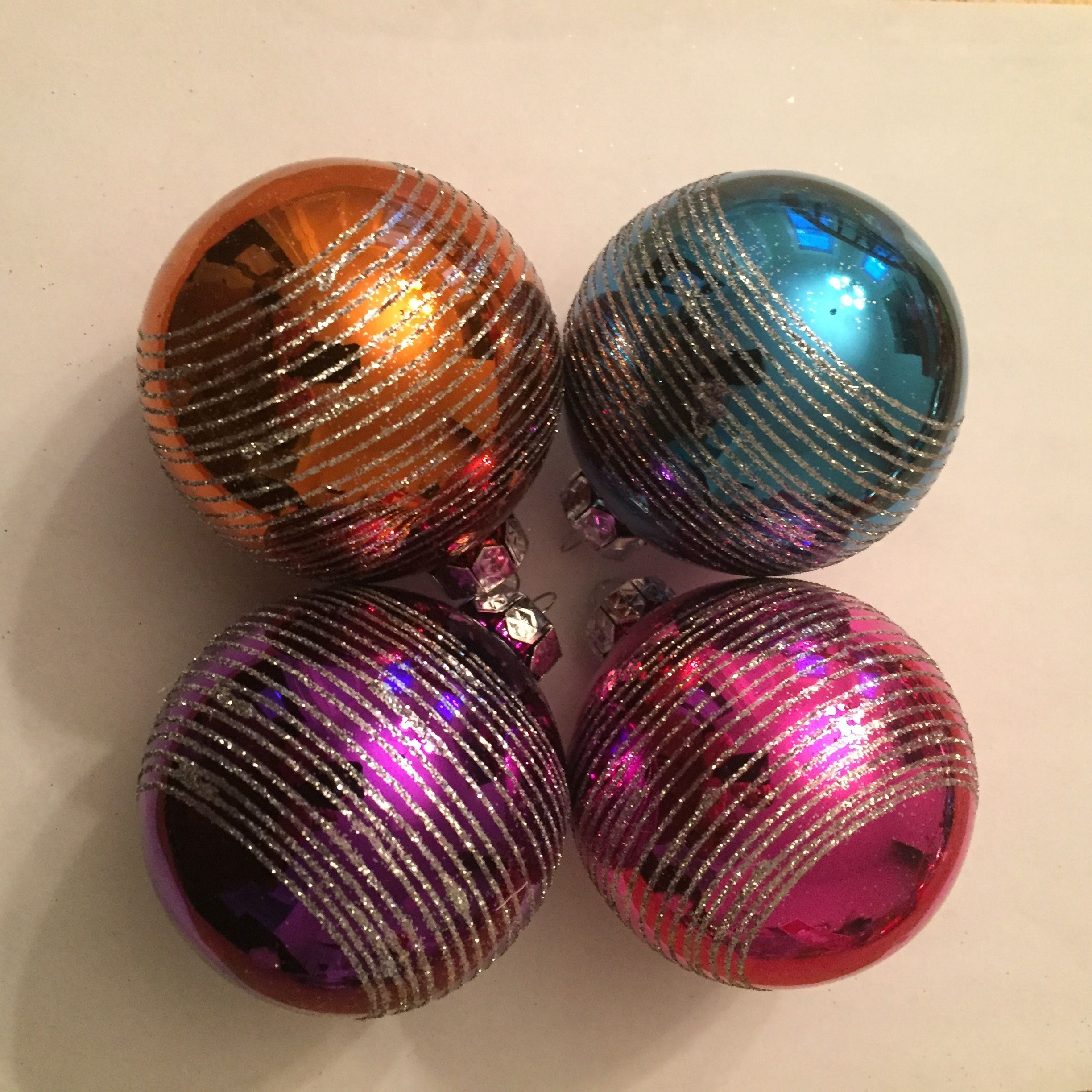 Multi-Colored Ball Ornaments | glass - 2 5/8 in. | 4 ornaments | Bought at Walmart | This is my color scheme: turquoise, raspberry pink, purple, and orange. I think they are a good fit with the Mexican tree - wish I had bought more!.