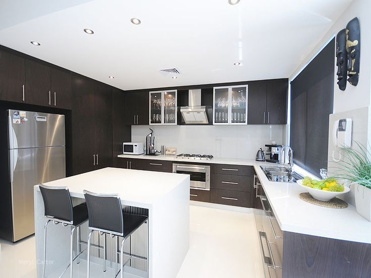 modern u shape kitchen with dark cabinet and white island with