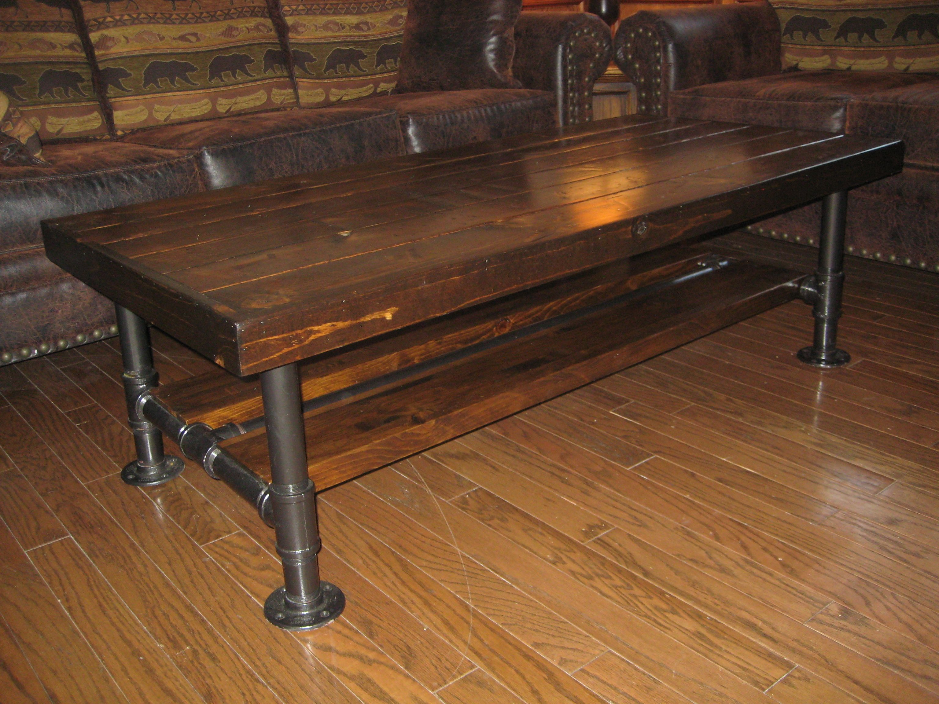 Distressed rustic knotty pine coffee table with steel for Rustic pipe table