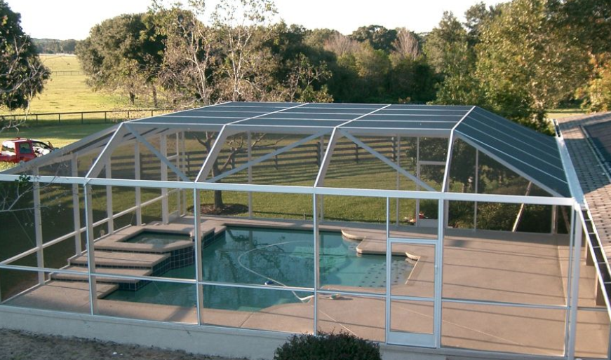 Shade And Shelter Your Pool Area Swimming Pool Enclosures Pool Enclosures Custom Swimming Pool