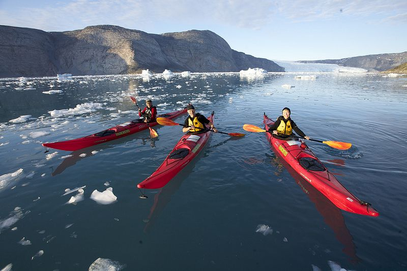 Kayakers In Front Of A Glacier Photo By Glenn Mattsing
