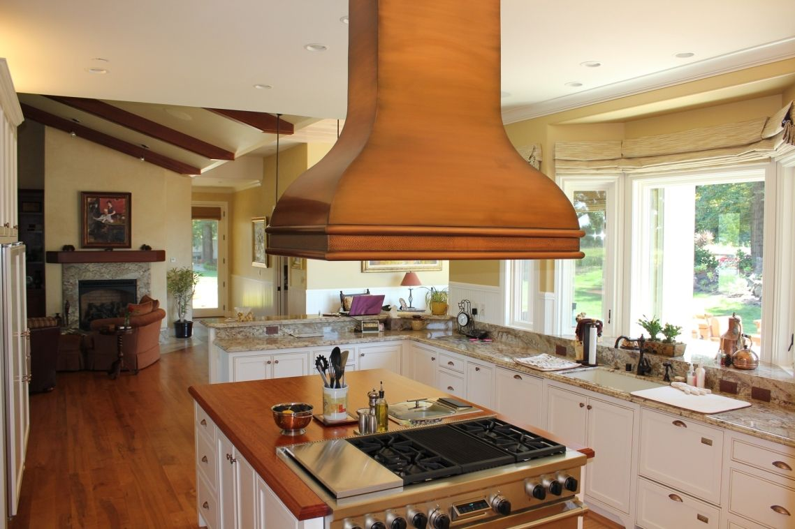 Vent Range Brown Stained Wooden Chimney Hood Over Rectable White Wooden  Island Built In Black Iron Burner .