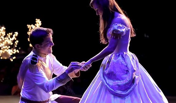 With His Girlfriend Dressed As Cinderella At Center Stage A Man In