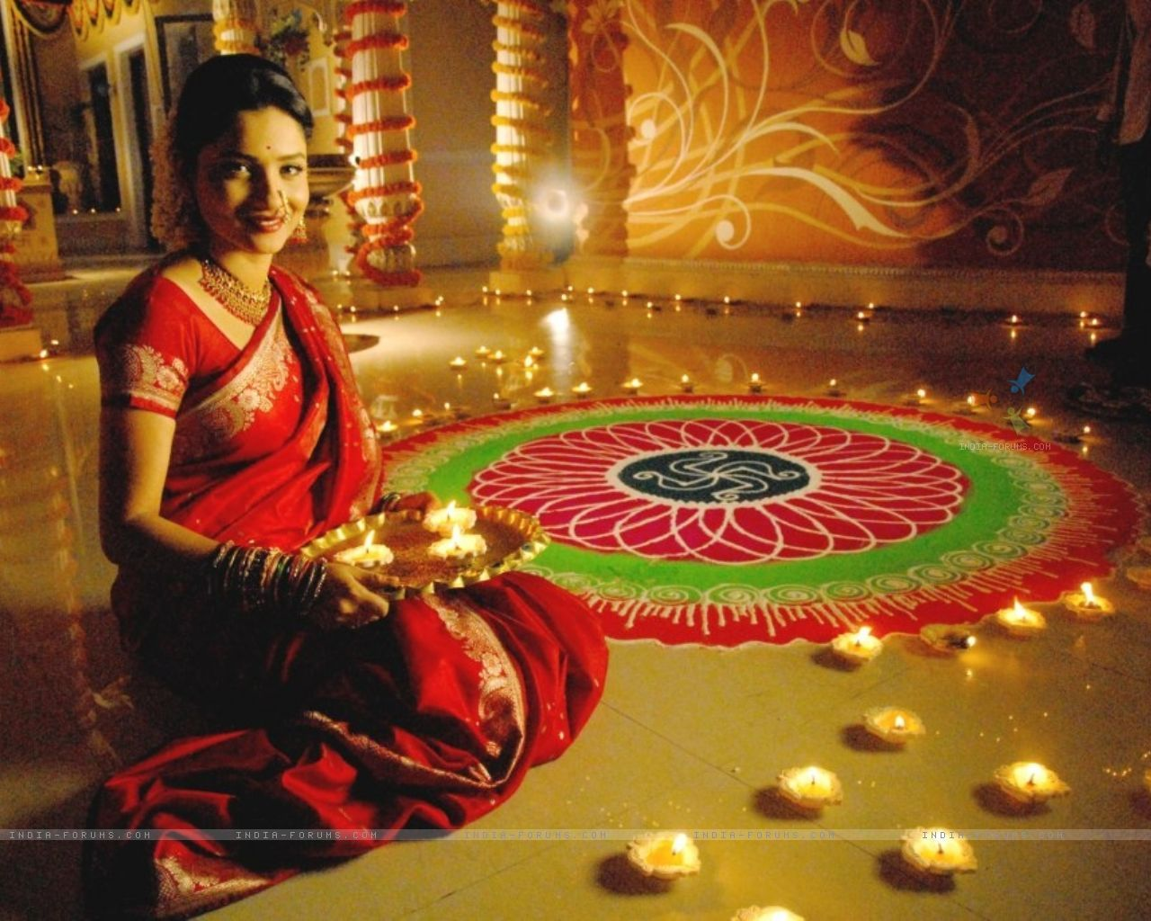 A traditionally dressed woman beside the rangoli an art work done shubh diwaliwish you a happy diwalidiwali pictures diwali information are available in this site kristyandbryce Gallery