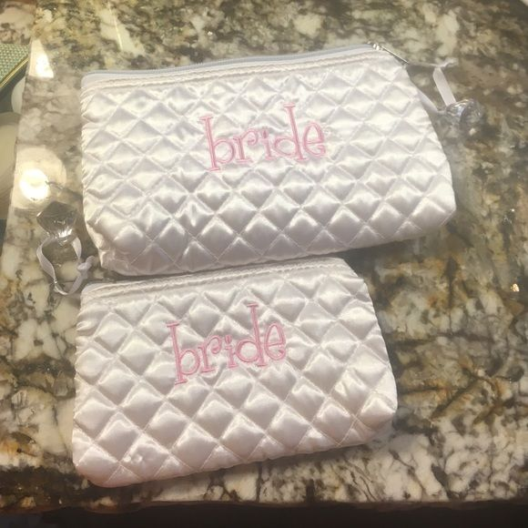 """Mudpie """"Bride"""" quilted satin pouch set Cute little """"bride"""" pouches (set of 2) would be so cute in getting ready photos from your big day or for packing things for various wedding events or your honeymoon! Received as a gift in a set of 3 and never used these two sizes so they are your gain! The zipper pulls are plastic """"diamonds."""" Larger size is approx. 8x5 inches. Smaller size is approx. 6x4 inches. Mudpie Bags Cosmetic Bags & Cases"""