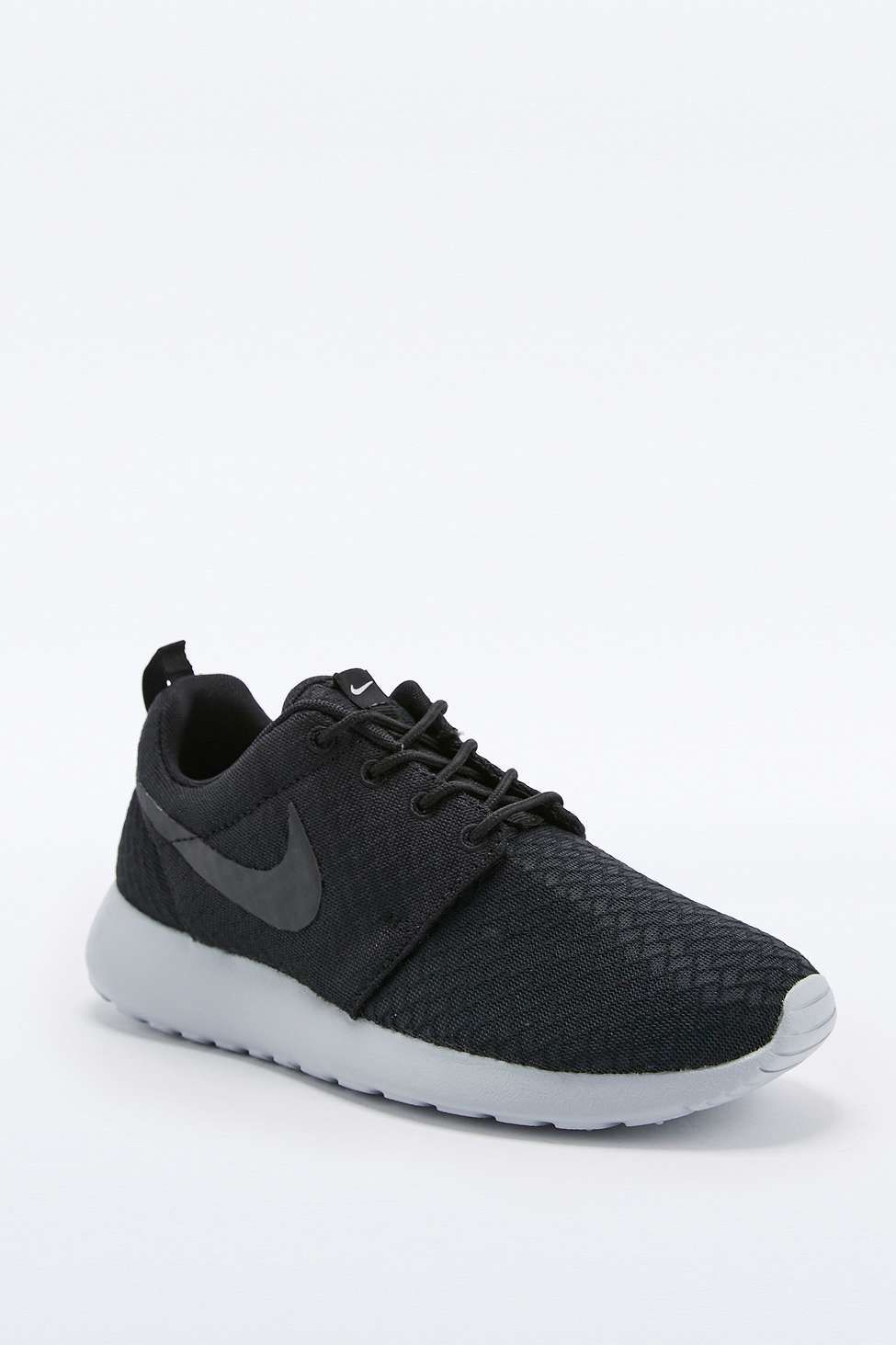 3796b6f1c9e3 Shop Nike Roshe Run Black and Grey Trainers at Urban Outfitters today. We  carry all the latest styles