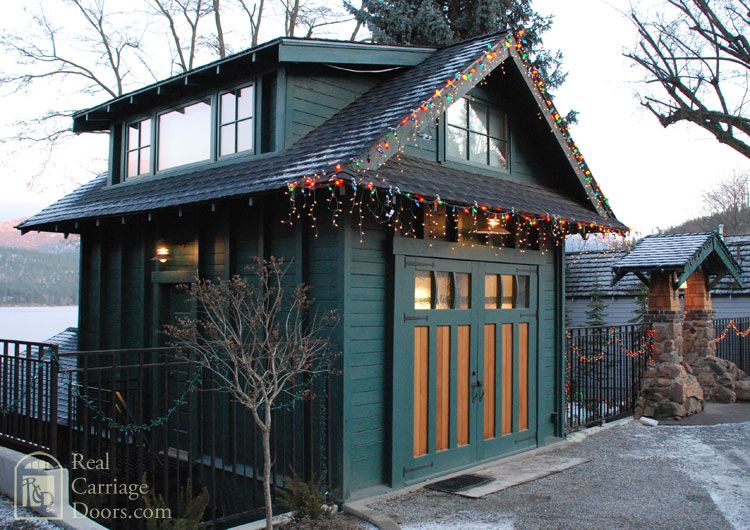 Check out the beautiful carriage doors on this tiny garage (that could be an entire house!). | Tiny Homes