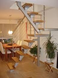 Resultado de imagen para escaleras madera y hierro poco espacio