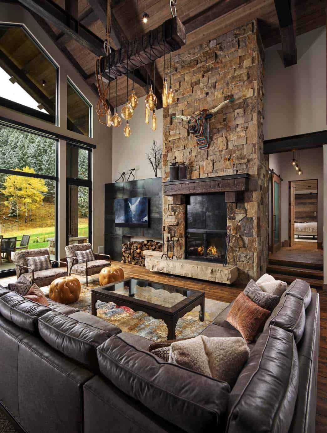 Photo of Tall two-storey stacked stone fireplace