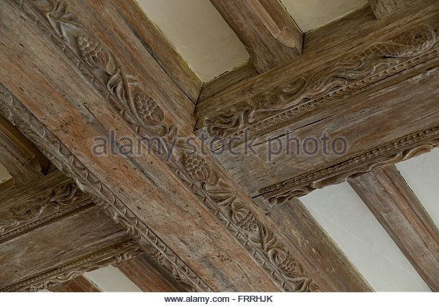 Decorated wooden roof or ceiling beams. Oak beams. Carved wood decoration…