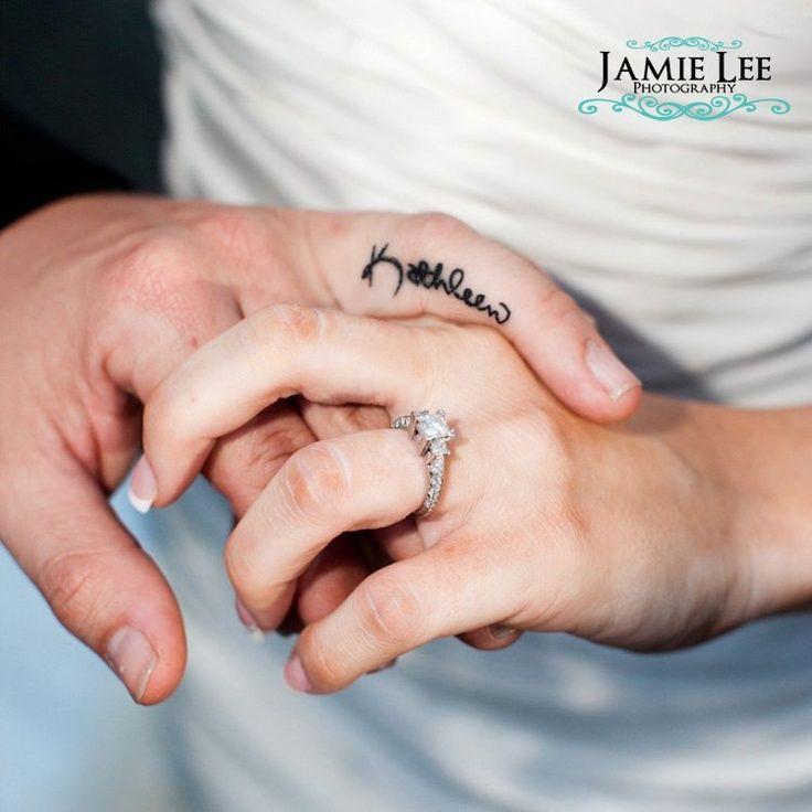 Wedding ring tattoo. Name tattooed onto finger Jamie Lee
