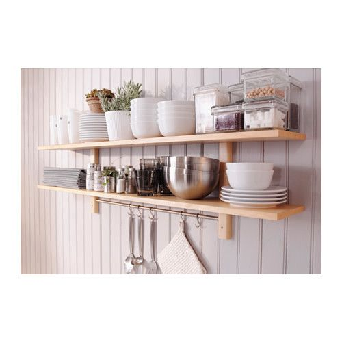 This set of shelves and hooks is perfect for storing cookery books ...