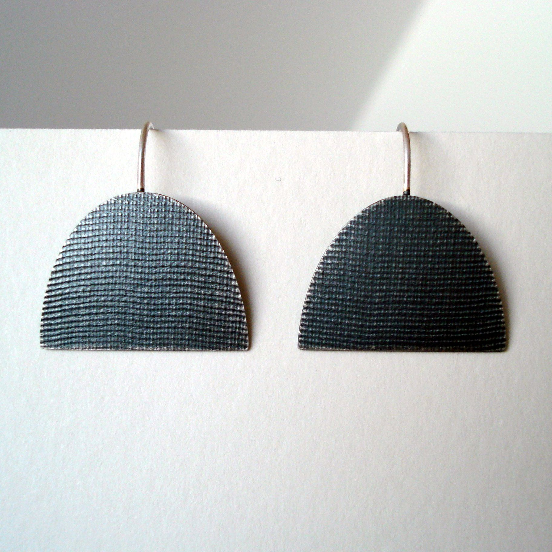 Large half oval oxidised earring   Contemporary Earrings by contemporary jewellery designer annabet wyndham