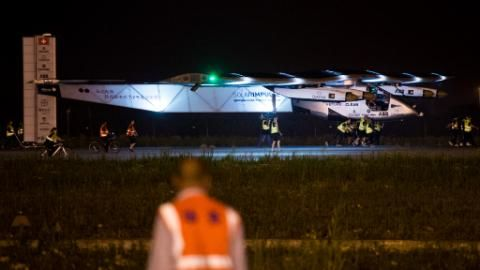 Crew members pull Solar Impluse 2 as it readies to take off from Nanjing's Lukou International Airport early on May 31, 2015