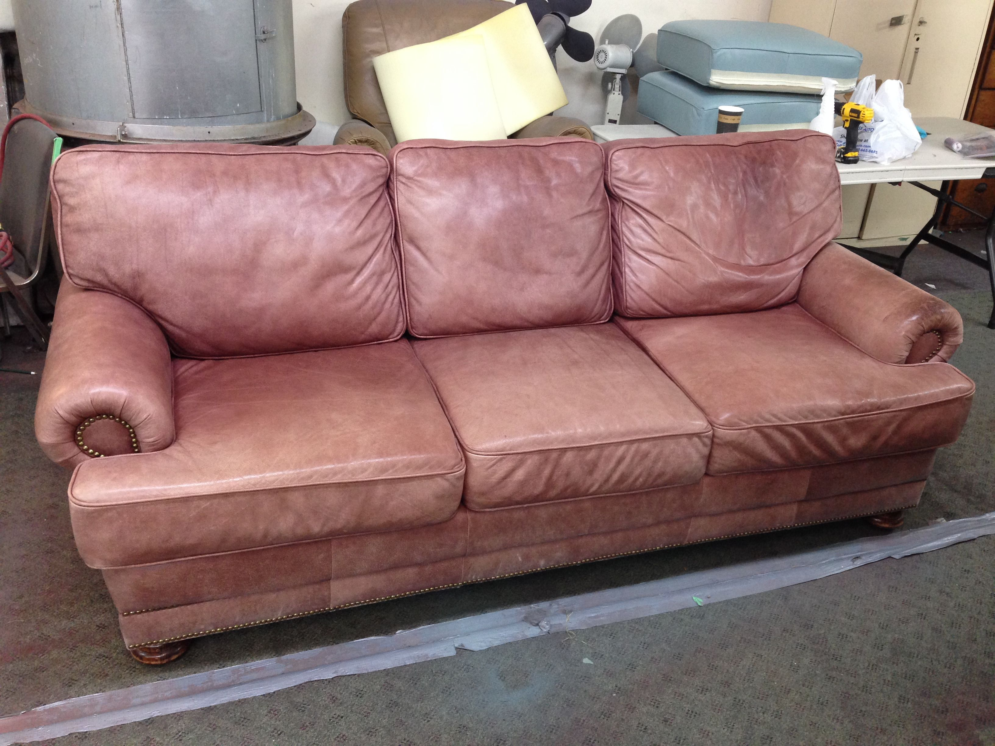 Faded leather Couch before picture