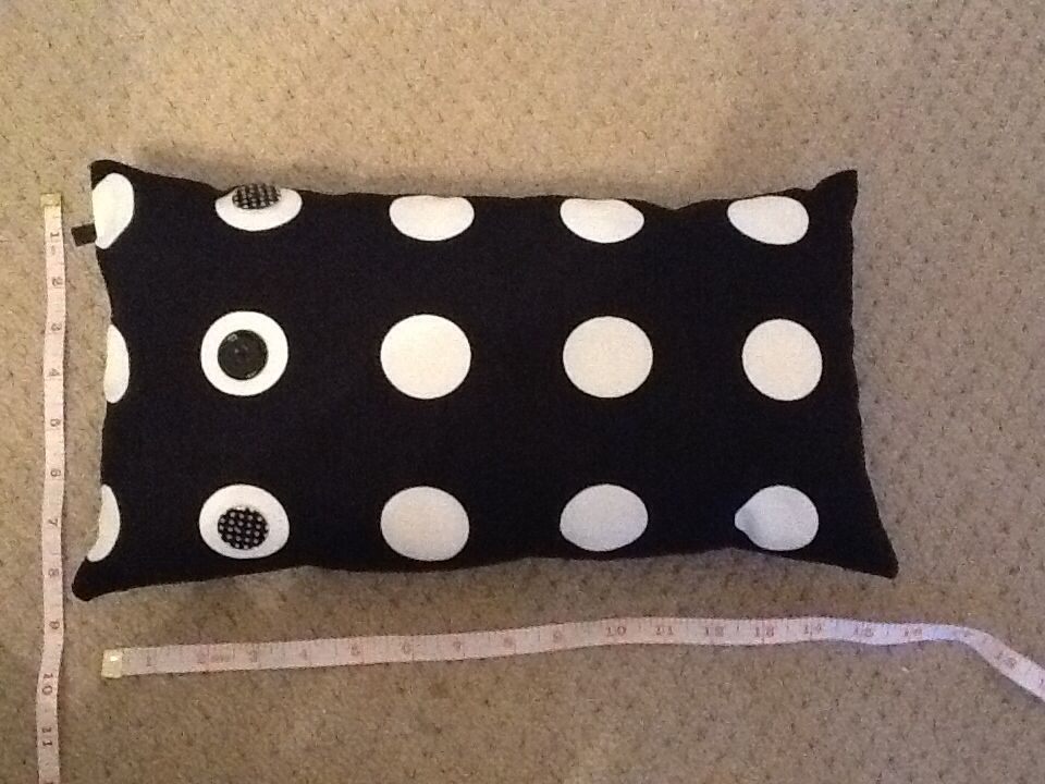 Polka dot cushion with side buttons