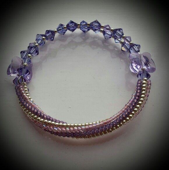 Very pretty! Swarovski crystals and twisted tubular herringbone.