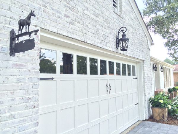 This brick rancher was painted using old white chalk paint White painted brick exterior