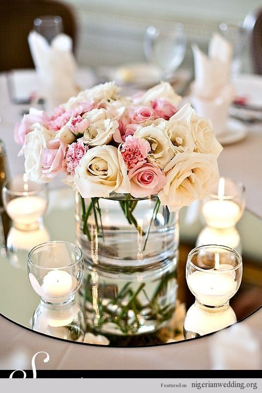 Centerpiece ideas- mixed white flowers on a mirror with candles, this will have a very romantic feel, and probably right for the room!