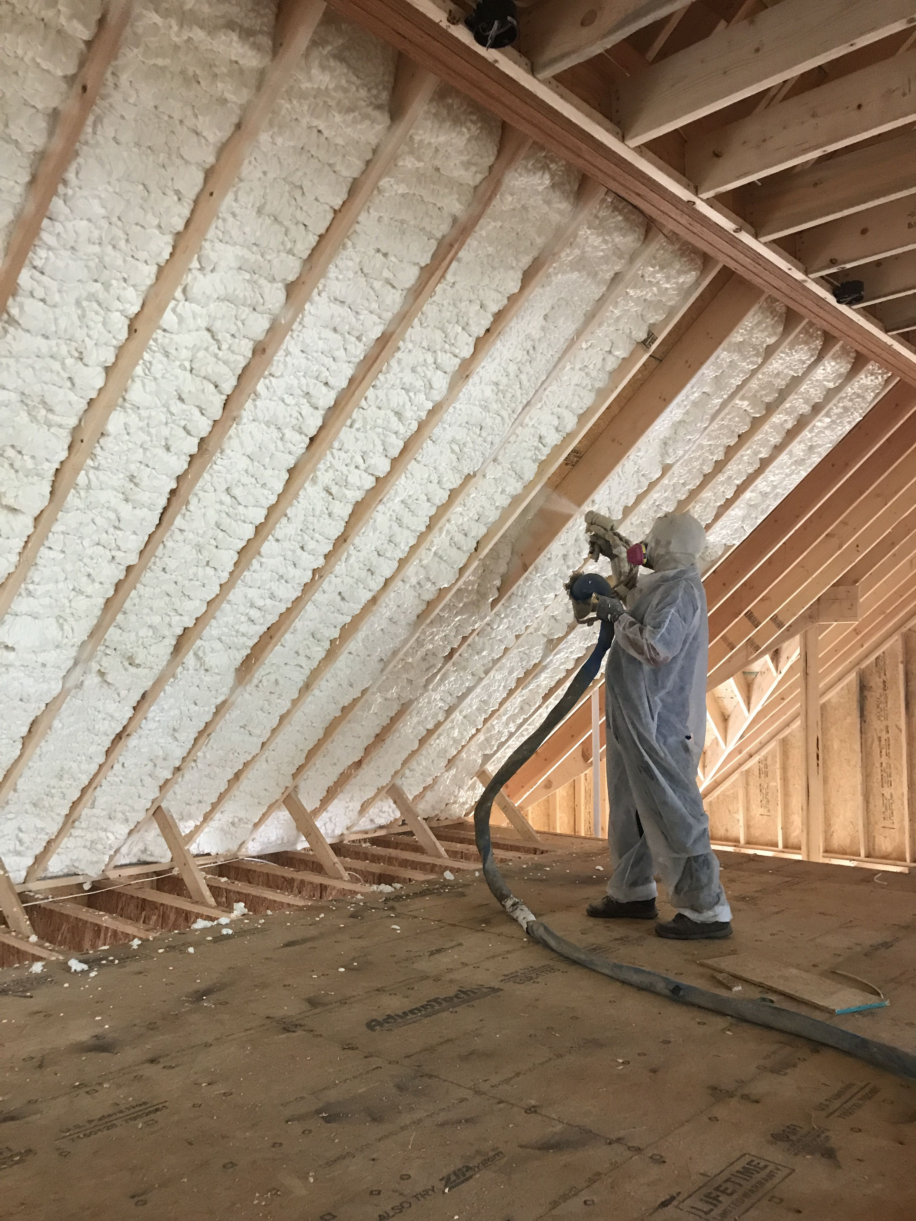 One Of Our Dedicated Workers Installing Spray Foam Insulation For A Lucky New Home Owner Installed By Mpi Foam Spray Foam Insulation Spray Foam Insulation