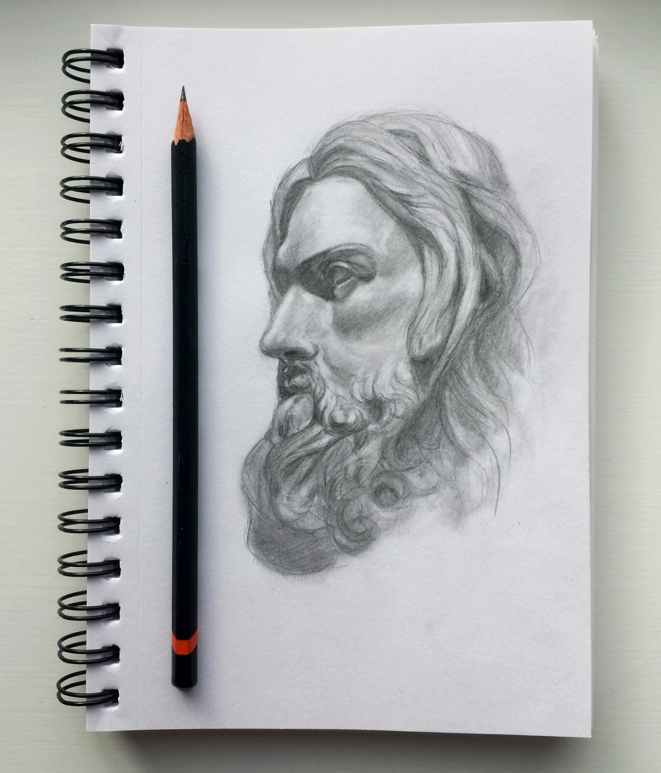 Small pencil sketch of a jesus statue