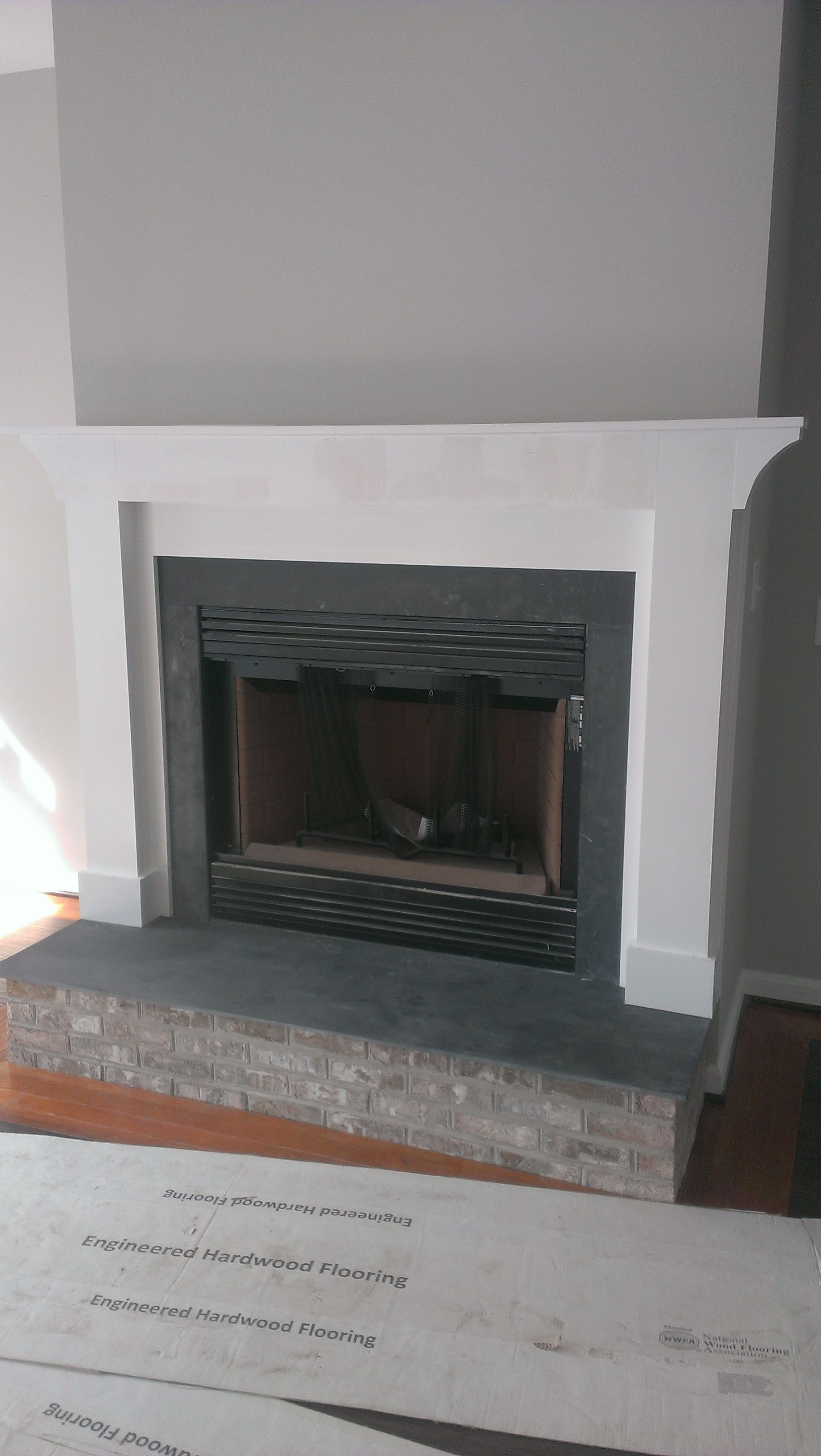Raised fireplace hearth with bluestone and matching brick ...