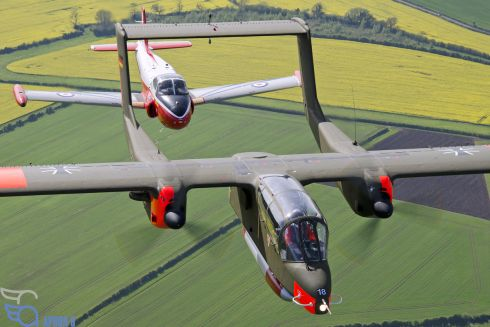 Former Luftwaffe target tug North American OV-10 Bronco leads ex RAF Ba (formerly Hunting and later Bae) Jet Provost trainer, during a photo shoot.