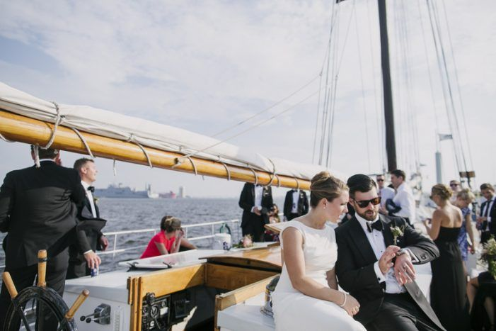 boat wedding exit, water wedding exit, baltimore wedding send off, sailboat wedding inspiration  from metallic modern baltimore harbor wedding by Love life images