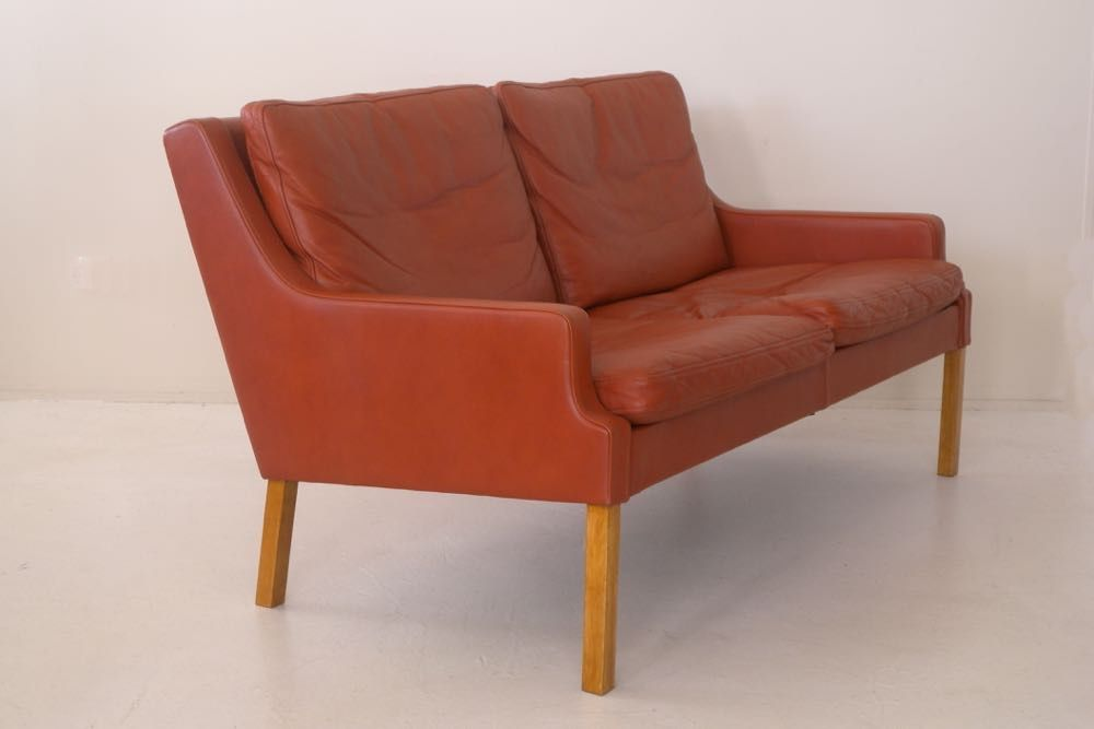 Two seater leather sofa by Gustav Thams