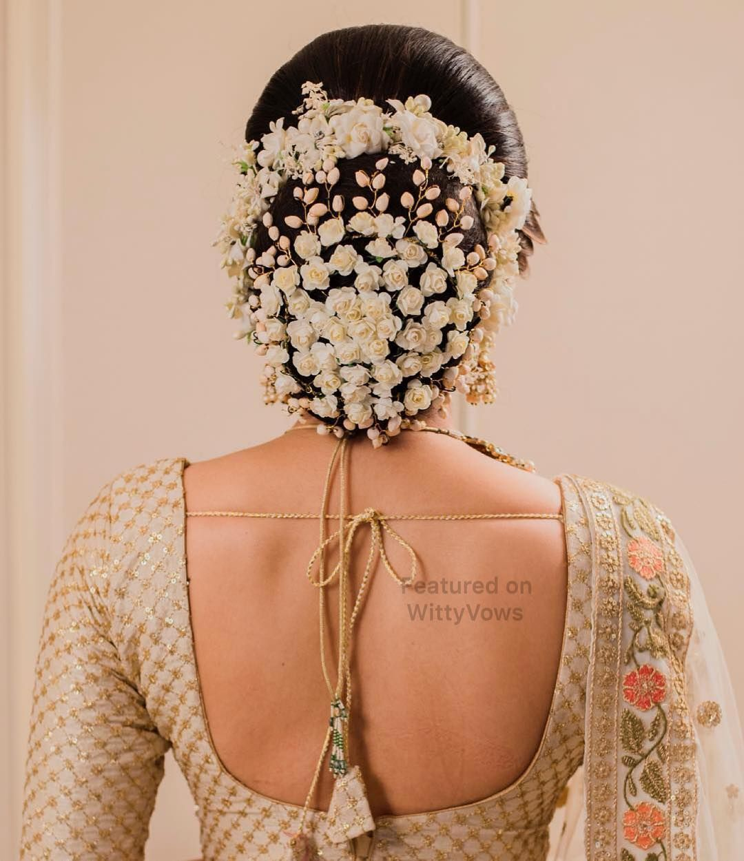 Bridal Hairstyle Goals Stunning Bridal Buns Adorned With Flowers Floral Bri Bridal Hairstyle Indian Wedding Indian Bride Hairstyle Indian Bridal Hairstyles