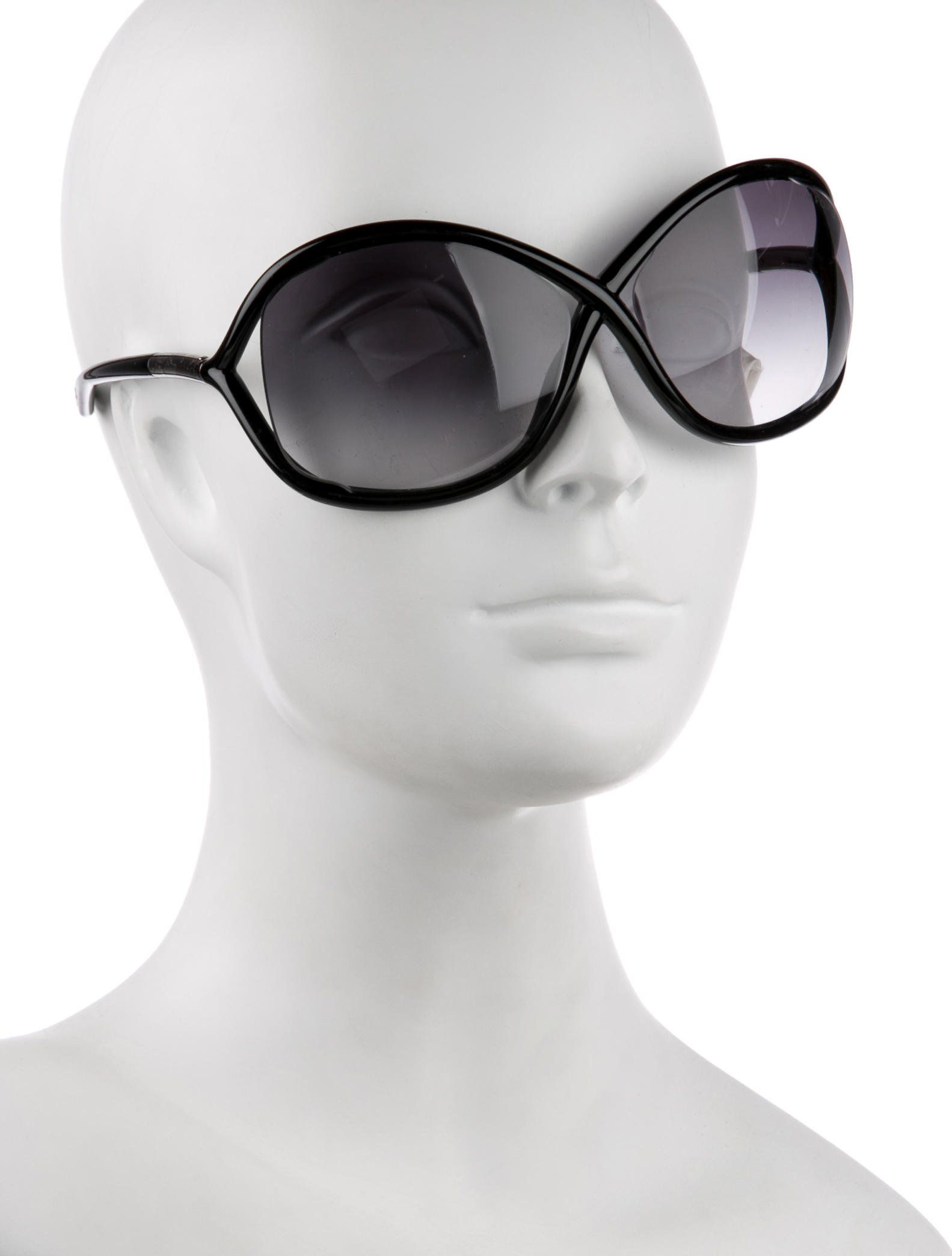 38c0d5255d50 Black acetate Tom Ford Whitney sunglasses with black gradient lenses at oversize  butterfly frames and silver-tone logo accents at temple tips. Includes case
