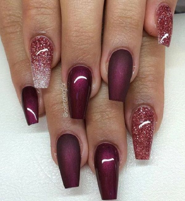 Amazing gradient inspired maroon nail art design. The silver and maroon glitter polish makes a great combination and gives a youthful glow to the nails. Contrasting the glitter polish is the dark maroon polish.