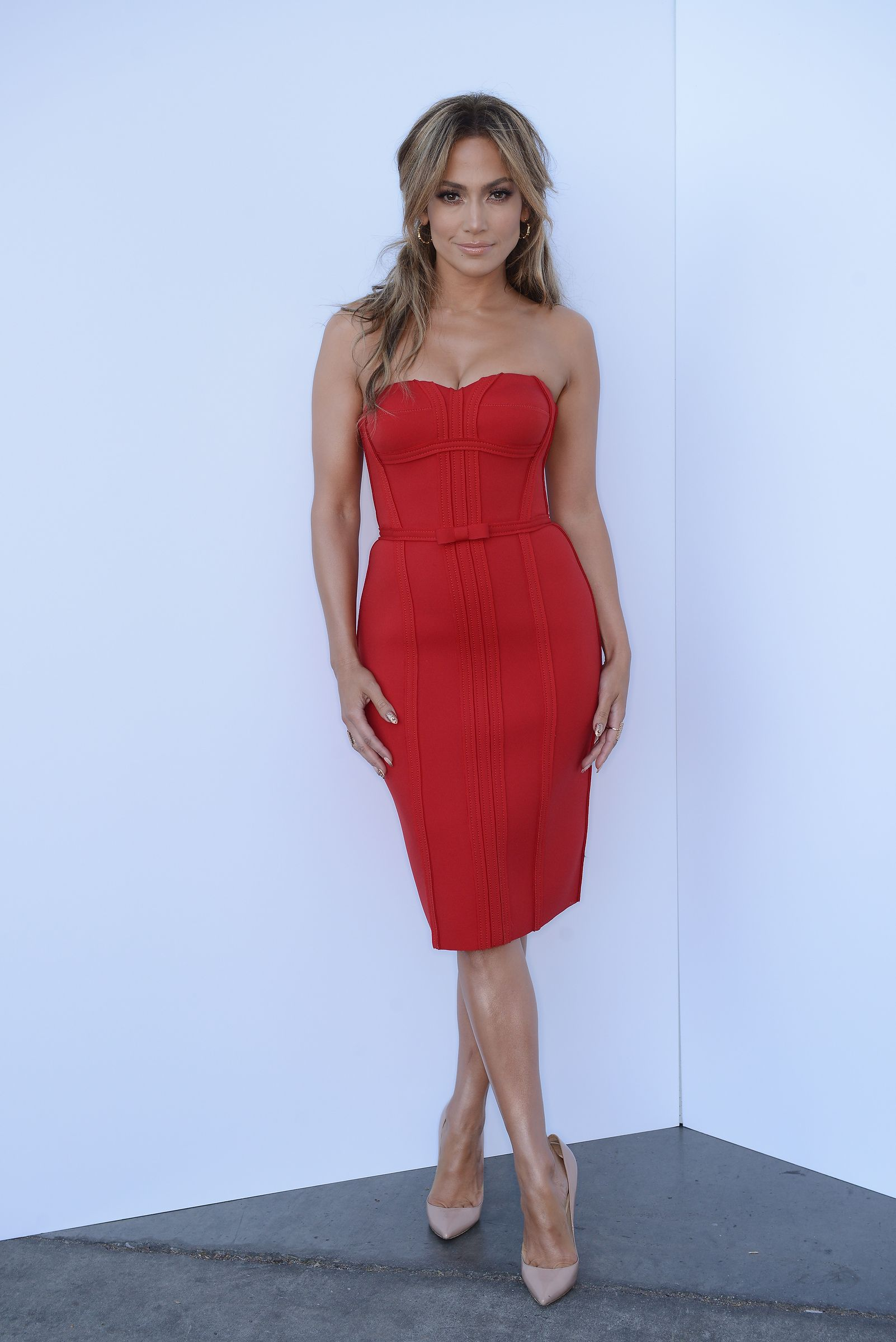 933adf6103 Jennifer Lopez wearing a Lanvin red strapless dress with Christian  Louboutin nude patent pumps on American Idol. Styled by  RandM.  IdolFashion