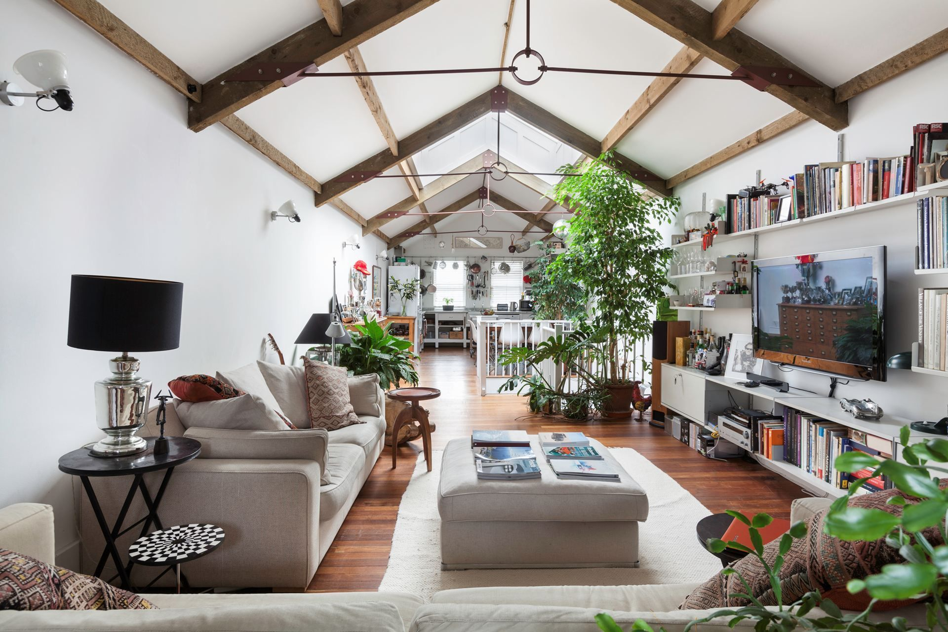 An incredible and rare two-bedroom maisonette featuring a vast warehouse-style reception space, complete with vaulted ceilings and beautiful exposed wood beams.