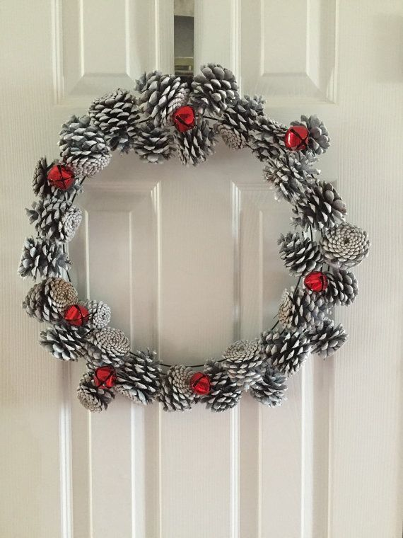 White pine cone wreath with red bells by ReagyLaneDesigns on Etsy