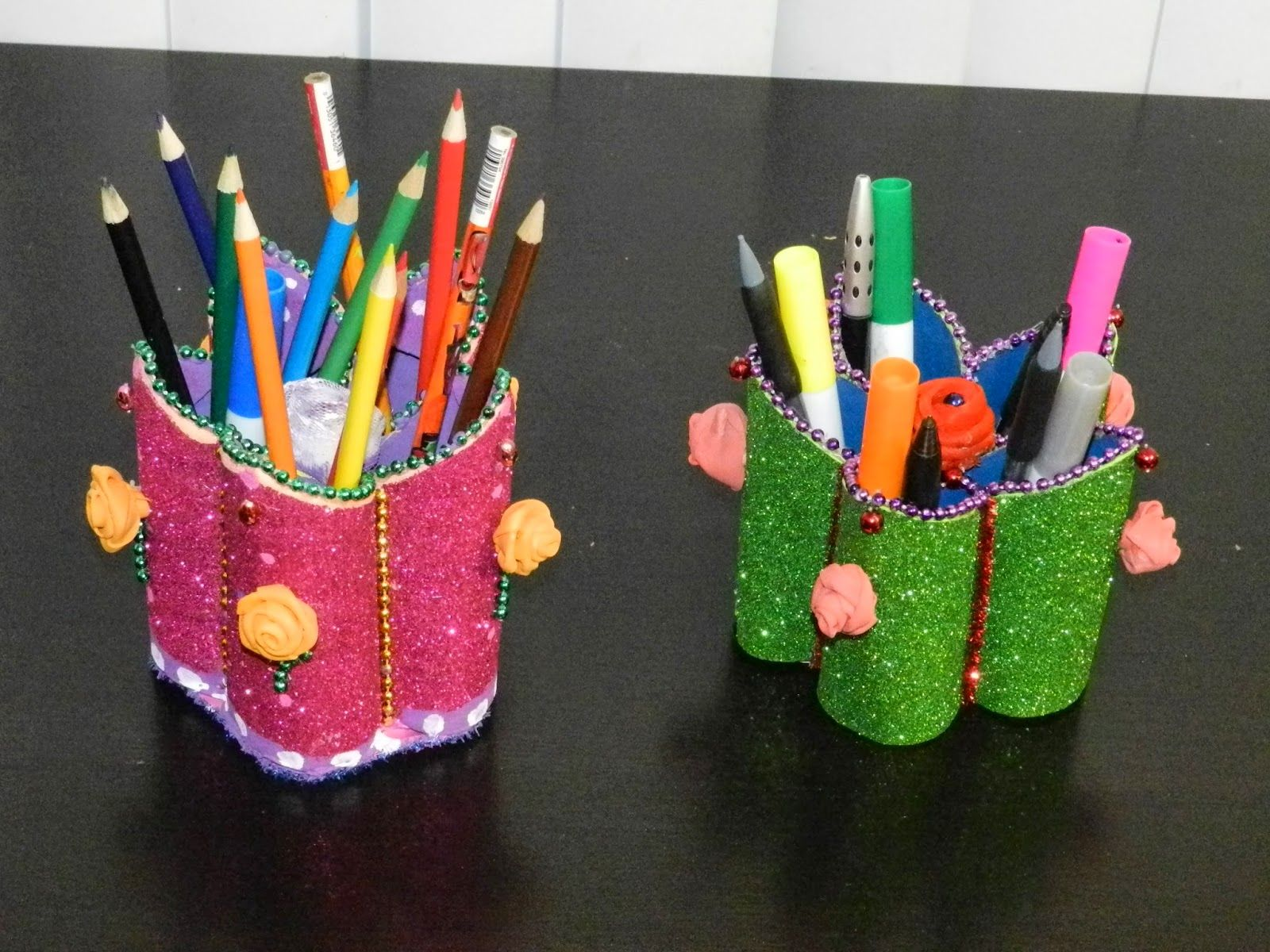 Creative diy crafts flower shaped pen stand holder with for Waste material craft on paper
