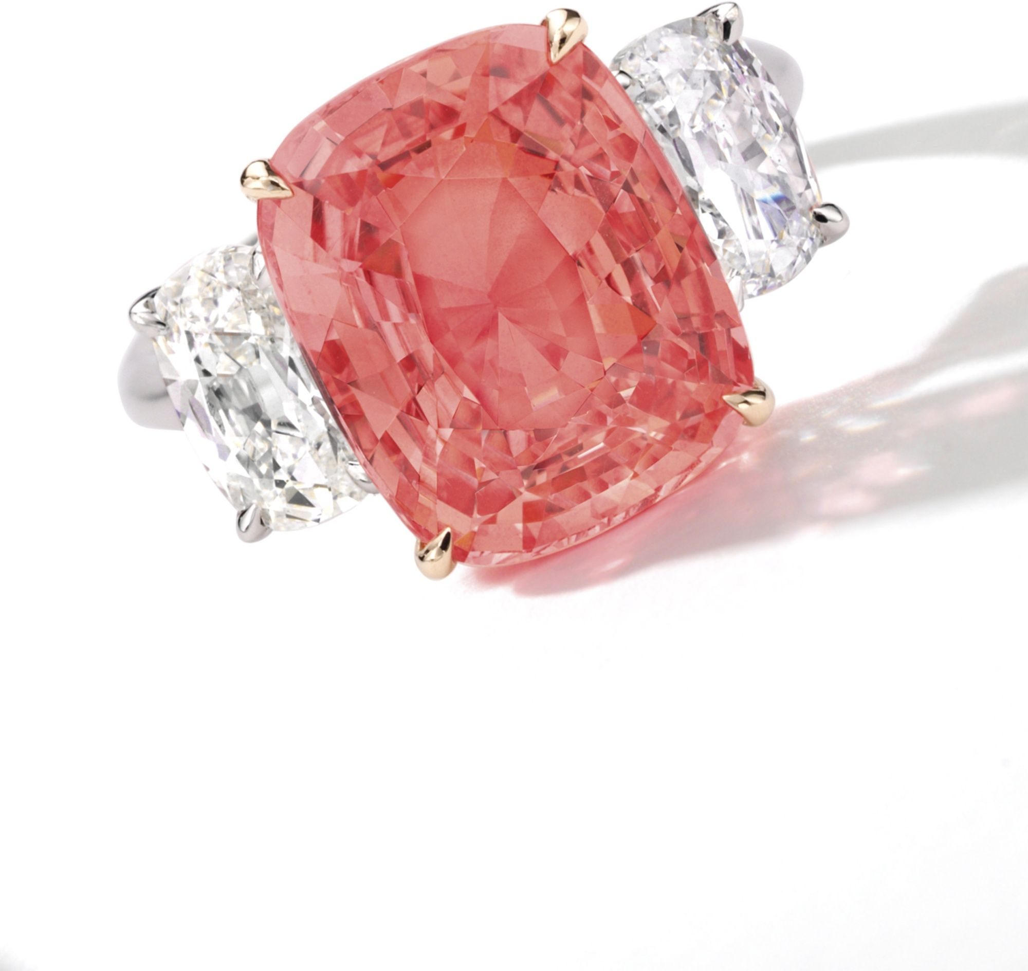 shoulders within floral christie with set hong brilliant auction kong diamond carats oval motif cut gallery shaped sapphire padparadscha surround an at may from a weighing pin trifurcated earrings jewels s and the magnificent approximately