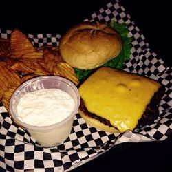 Lebowski's Bar & Grill - Robins, IA, United States. Cheeseburger with homemade Chips and cottage cheese