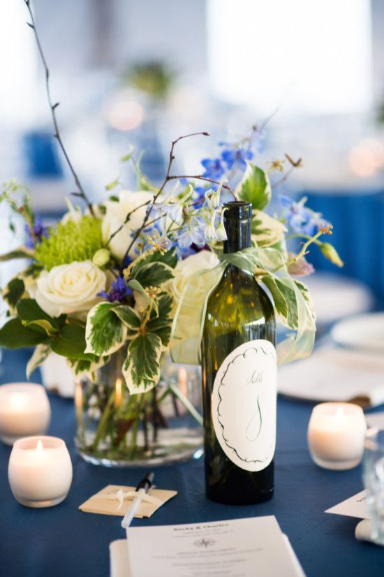 Wine bottle table numbers + navy and green wedding decor. At this Chicago Yacht Club Wedding http://www.weddingchicks.com/2014/04/20/chicago-yacht-club-wedding/