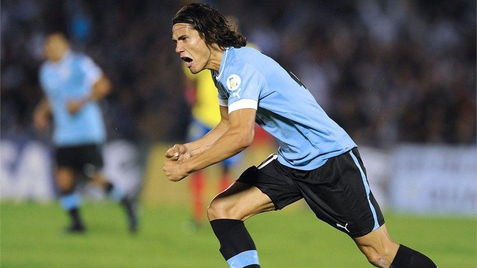 Uruguayan forward Edinson Cavani celebrates after scoring
