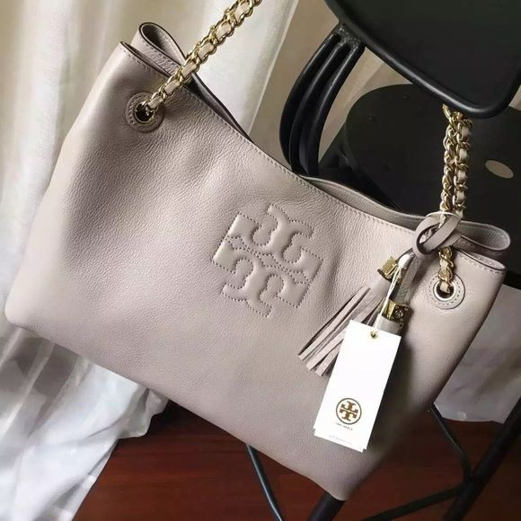 8a3825ff85ba Tory Burch Thea chain slouchy tote  gray My last one Thea slouchy in this  color. So no lowball offer thanks. Leather and chain strap with 9