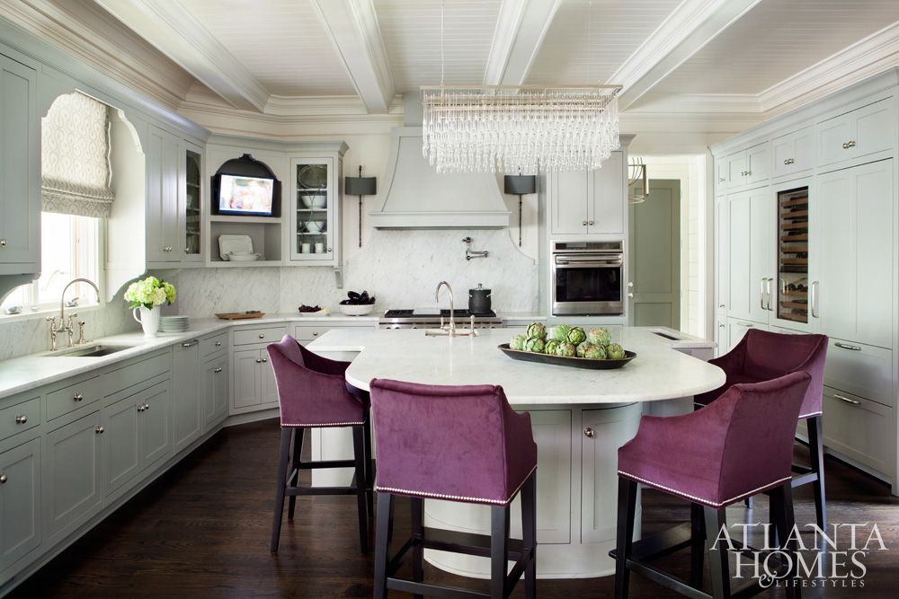 Eggplant Hued Barstools Bring Liveliness To The Soft Gray Kitchen. The  Oversized Ceiling Fixture