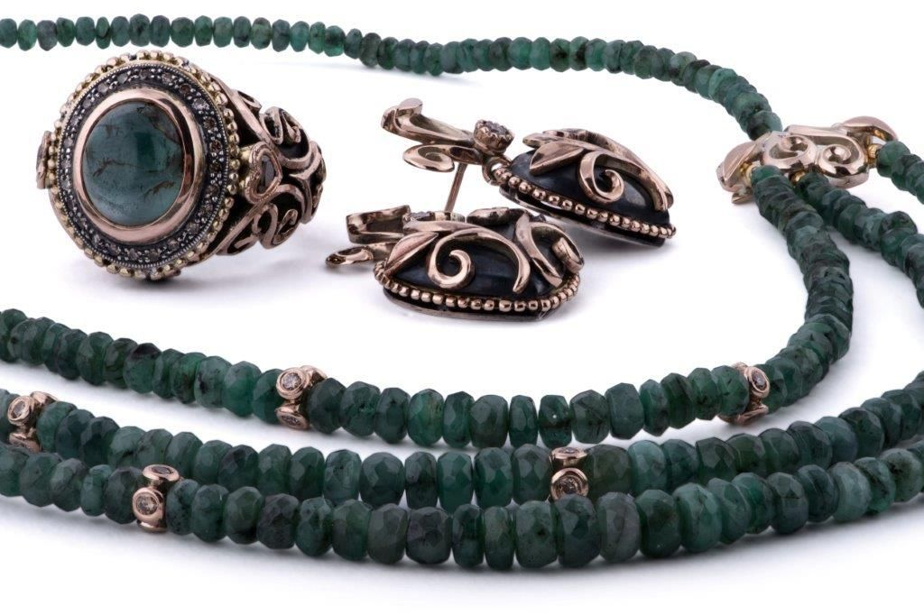 GALACIA DESEGNER JEWELLERY- Emerald and brown diamonds set in oxidized silver, rose gold ring, earrings and neckpiece.