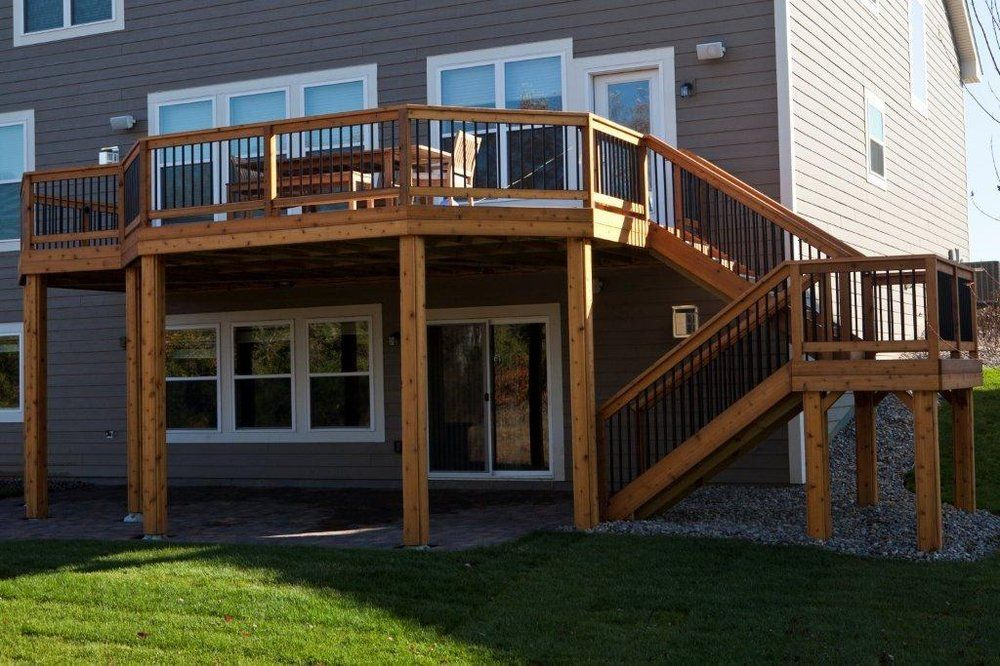 Deck and basement company minneapolis deck builder for Walkout basement backyard ideas