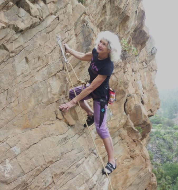 """ANGELA SOPER, in her 70's """"...The part of me that always stands aside from our antics seemed to say, 'What are they doing, these middle-aged women?'. And the active part replied, 'Rubbish. Let them stay young and daft until they're old and strange.'"""" (image from her Facebook page, shown using ropes, but equally capable of casually solo-ing around. Link goes to a brief bio, with clickthroughs.)"""