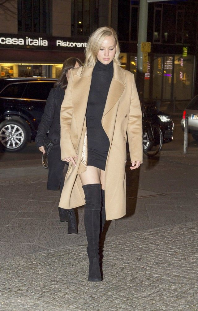 8cdaa9825bf1 Jennifer Lawrence wears a black minidress, camel coat, and thigh-high suede  boots